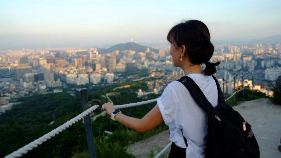 woman-looking-out-over-cityscape-physician-sabbatical